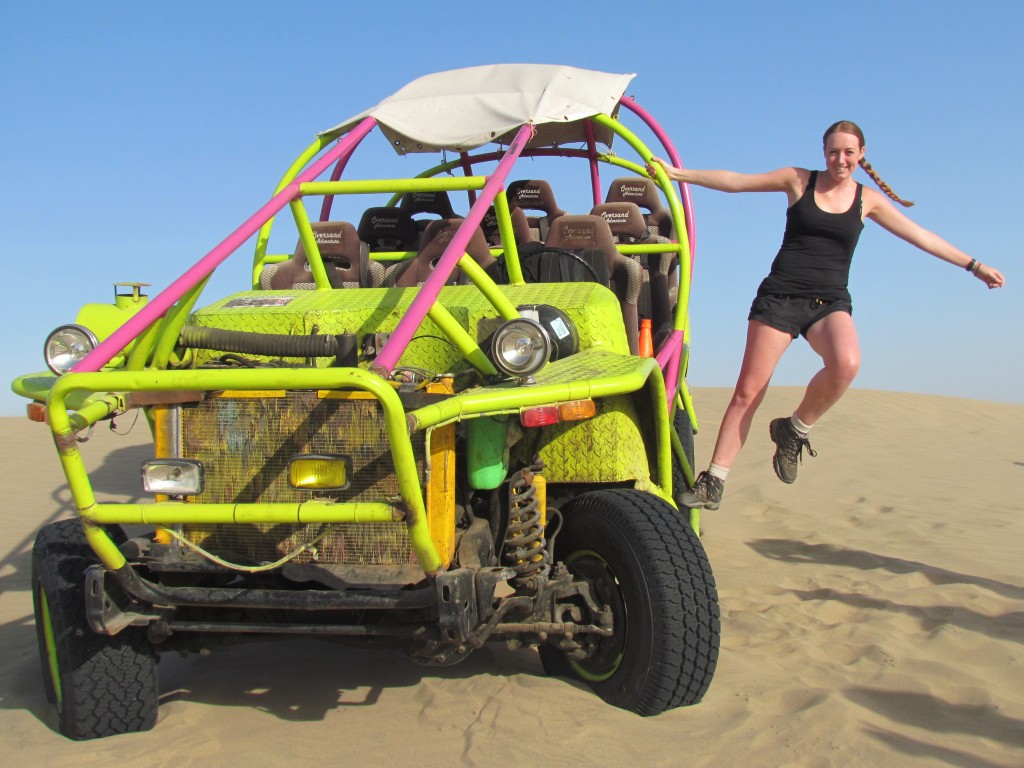 Sand boarding in Huacachina - hanging off the buggy
