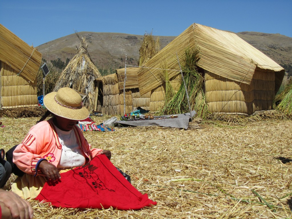 Floating Uros Islands - woman making souvenirs