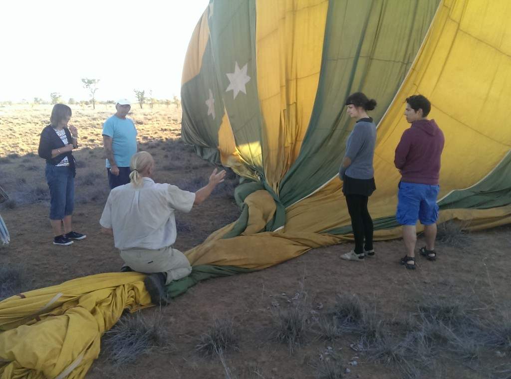 Outback Ballooning in Alice Springs - rolling the balloon