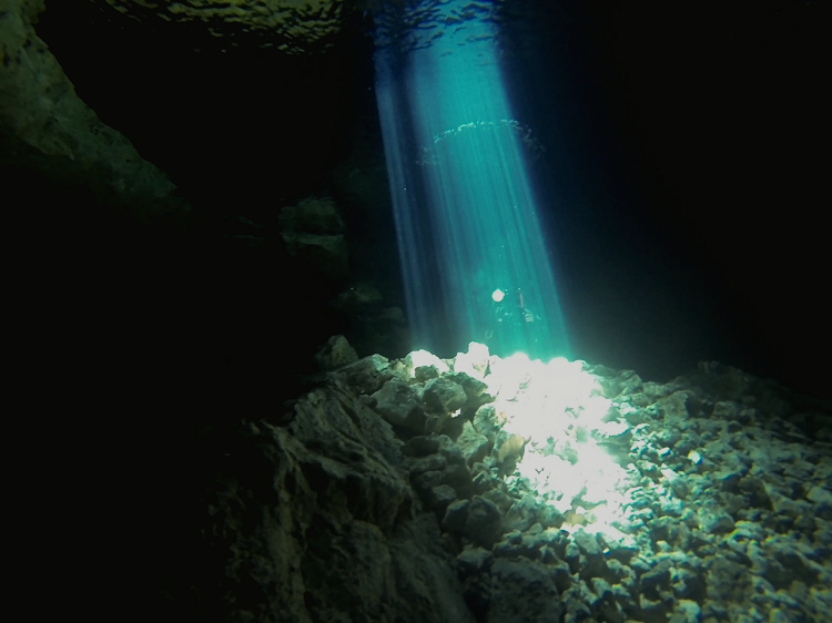 Cenote Diving in Mexico - Diving The Pit and the Taj Mahal - light beam