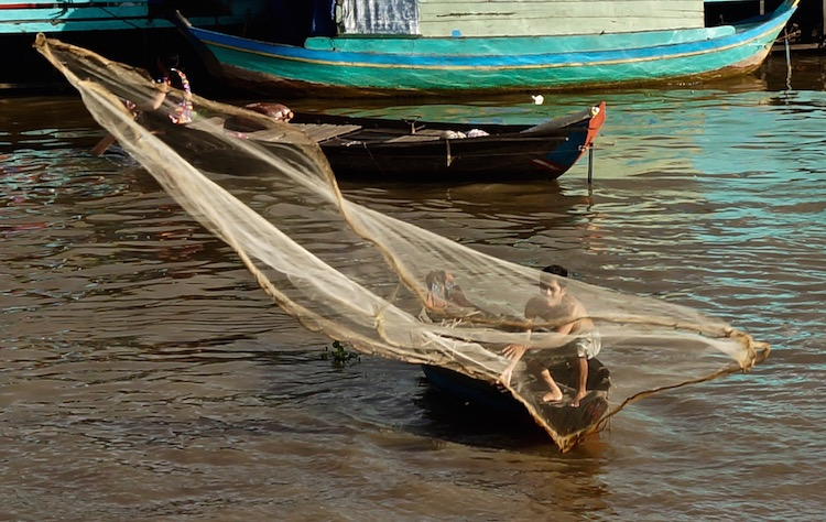 Floating Villages on Tonle Sap Lake - Fisher Man Casting his Net