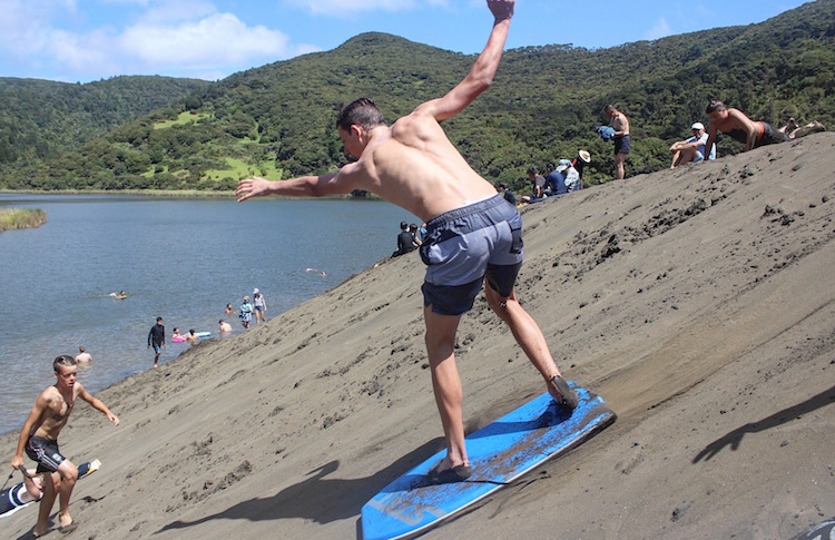 Top 10 Auckland Day Trips - Bethells Beach Boarding