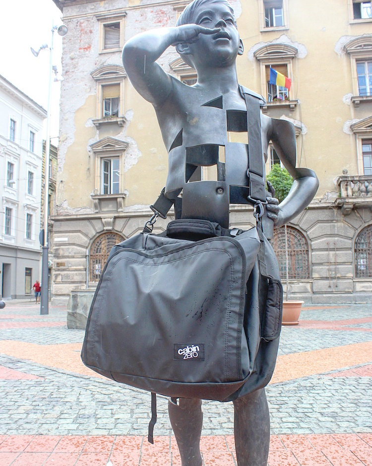 CabinZero - Urban Carry-On - On a Statue